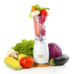 Blender with fresh vegetables isolated on white