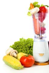 Blender with fresh vegetables isolated on white