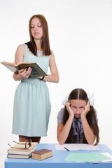 Schoolgirl sitting on a boring lesson