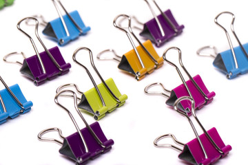several colorful office binder clips