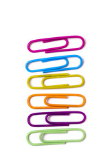 vertical line of colorful office paper clips