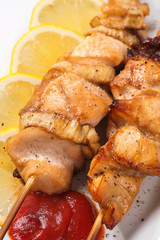 Grilled chicken meat on skewer
