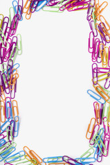 colorful office paper clips forming a rectangle