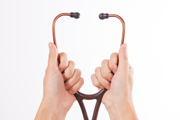 Hands putting stethoscope on isolated on white background