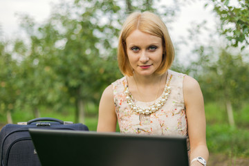 girl with laptop on the nature