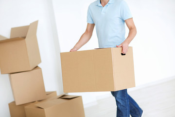 Man with a box indoors