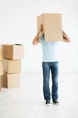 Man with a box at home