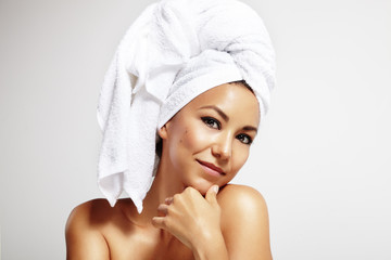 latin woman with the bath towel on the head
