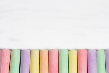 Colorful chalks in a row