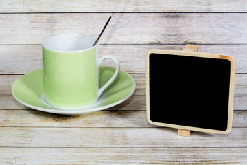 Coffee cup and empty blackboard