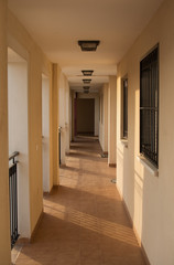 Spanish Apartment Hallway, sun's rays slanting across the floor