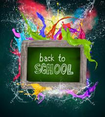Wooden blackboard with school supplies