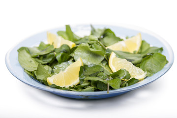 fresh and healthy watercress salad with lemon.