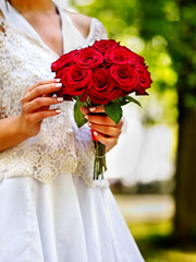Bride with red rose bouquet