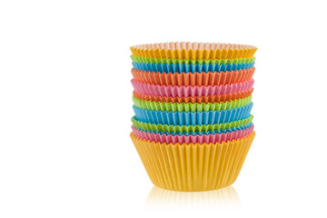 Colorful empty muffin cups on a white background