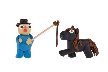Horse and Farmer with whip made of plasticine