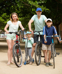 Parents and kids with bicycles