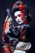 canvas print picture - young pretty geisha in kimono