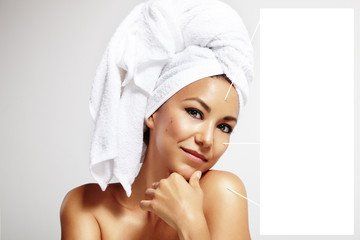 latin woman with a bath towel on the head and with the notes to