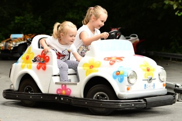 little girls steering in the toy car