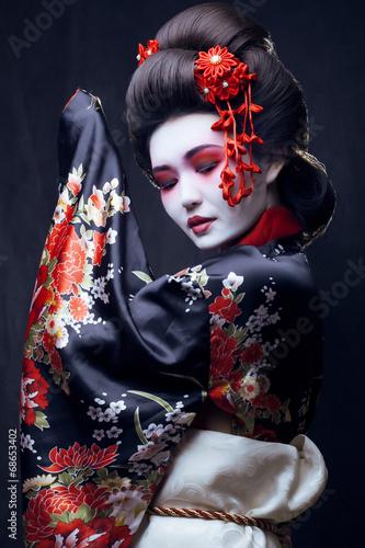 Leinwanddruck Bild young pretty geisha in kimono
