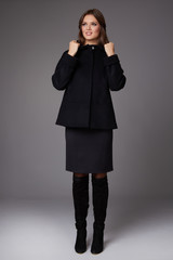 Business woman wearing wool coat jacket autumn collection