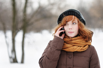Young beautiful woman using her mobile phone