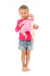 Little girl plays with favourite doll. Isolated over white