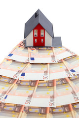 House and euro banknotes isoalted on white background