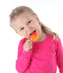 Little girl with ice cream on white background