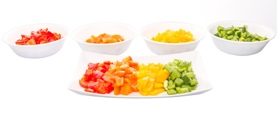 Colorful chopped capsicums in a plate and bowls