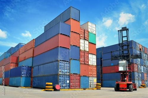 forklift handling the container box - 68656295