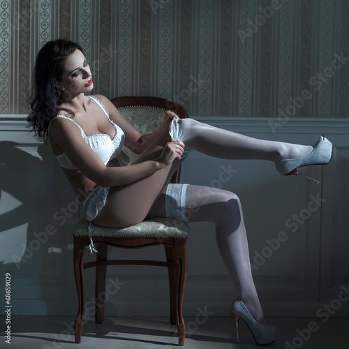 Sexy brunette woman strip