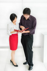 Thai (Asian) boss is ordering a task for his secretary in the of