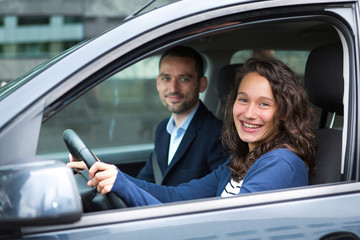 Young business man couple in their brand new car