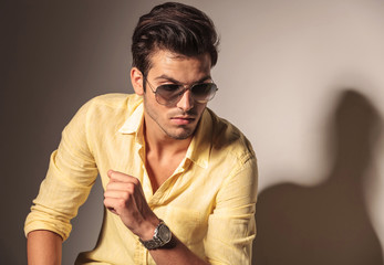 attractive sexy man wearing sunglasses and yellow shirt