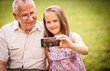 Grandchild with  grandfather capturing moments
