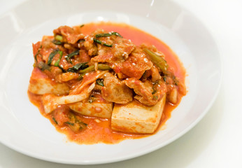 Kimchi and tofu on white background. It's creative Korean cuisin