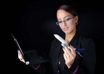 Woman With Model Airplane and Laptop