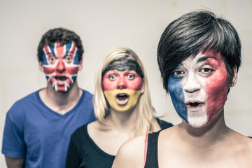 Surprised people with European flags on faces