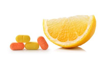Slice of lemon fruit and vitamin c isolated on white background