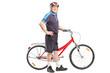 Active senior pushing a bicycle and posing