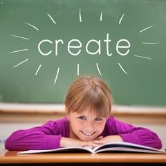 Create against cute pupil sitting at desk