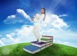 Composite image of student holding books