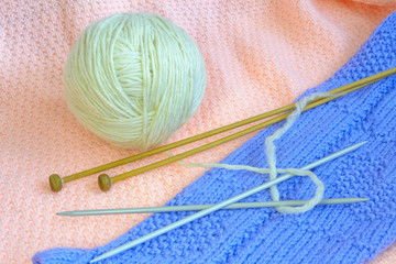 woollens yarn with knitting needle
