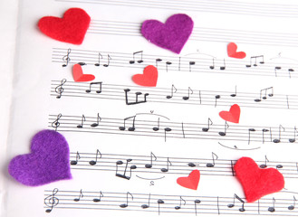 Decorative hearts on music book, close-up