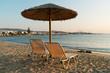 Sunbeds on sandy beach, Paros island, Greece