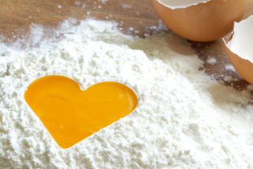 Yolk egg in flour love baking concept