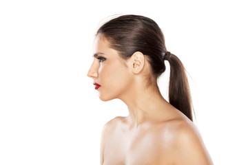 profile of a girl with a pony tail on white background