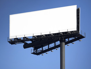 post with billboards over blue sky background